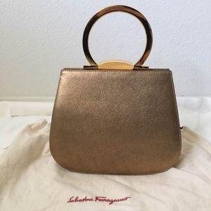 Authentic Ferragamo Gold Metallic Frame Handbag